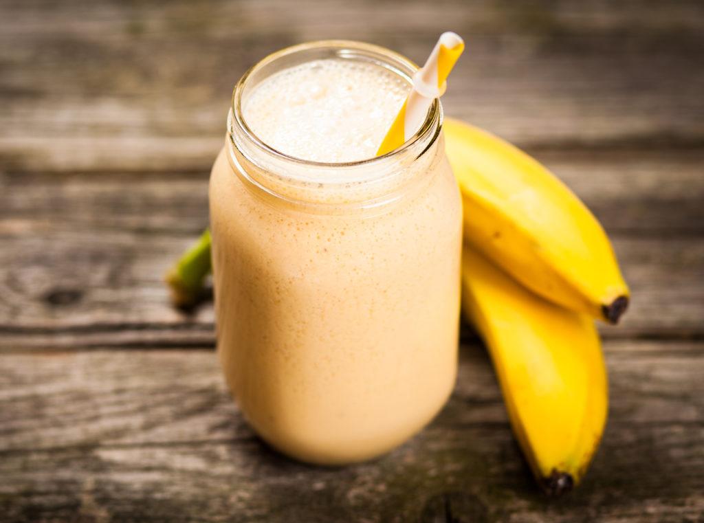 Banana milkshake on wooden table